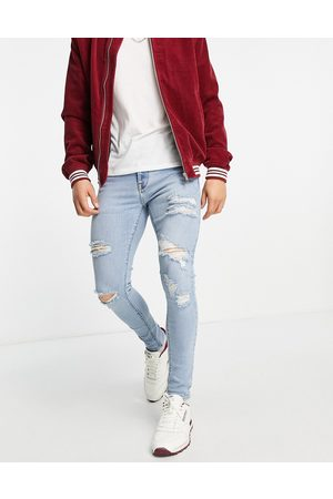 ASOS Herre Skinny - Spray on 'vintage look' jeans with powerstretch in light wash with heavy rips-Blue