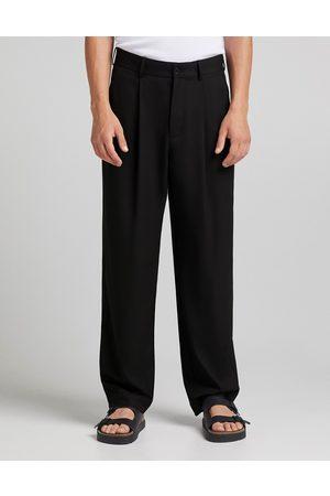 Bershka Herre Chinos - Wide fit pleated smart trousers in black