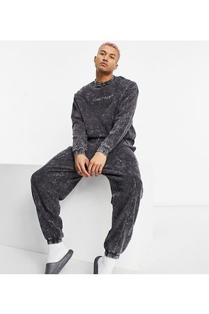 ASOS Herre Joggebukser - Relaxed jogger in charcoal wash with logo-Grey