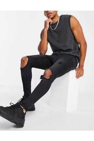 Topman Herre Skinny - Blowout super spray on jeans in washed black