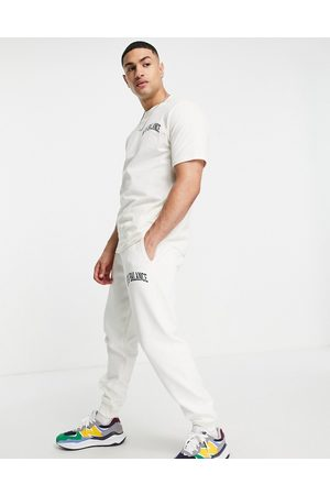 New Balance Herre Joggebukser - Collegiate joggers in off white and green