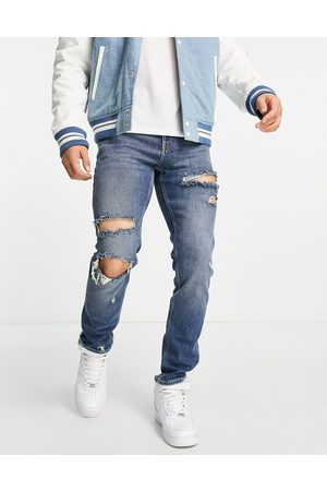 ASOS Herre Skinny - Stretch slim jeans in dark wash with extreme rips-Blue