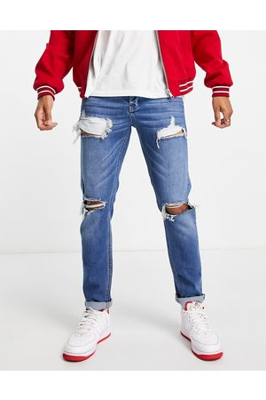 ASOS Stretch slim jeans in dark wash blue with heavy rips