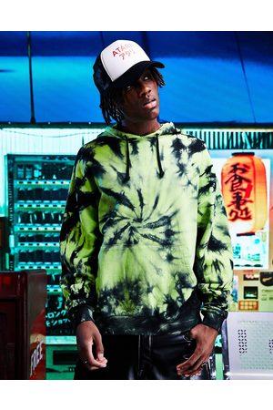 ASOS Oversized hoodie in acid green spiral wash