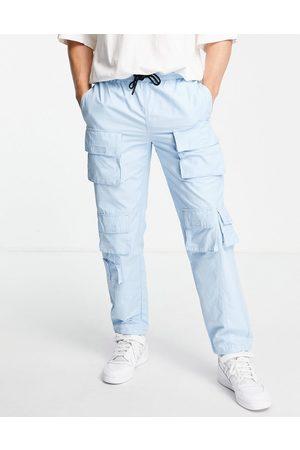 Topman Relaxed multi pocket cargo trousers in blue