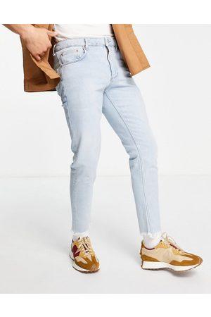 ASOS Herre Skinny - Stretch slim jeans in vintage light wash with raw hem-Blue