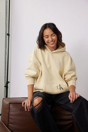 Calvin Klein for NA-KD Dame Hettegensere - Økologisk boyfriend hettegenser