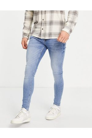 Topman Super spray on jeans in mid wash-Blue