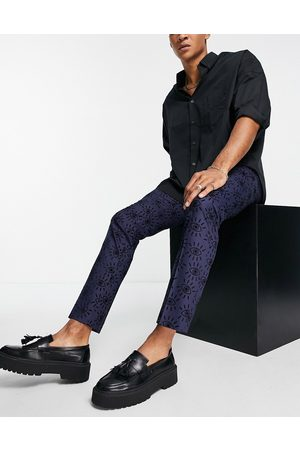 Twisted Tailor Suit trousers in navy with eye print flocking