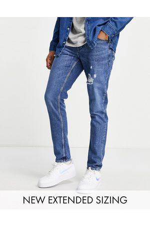 ASOS Stretch slim jeans in dark wash blue with abrasions