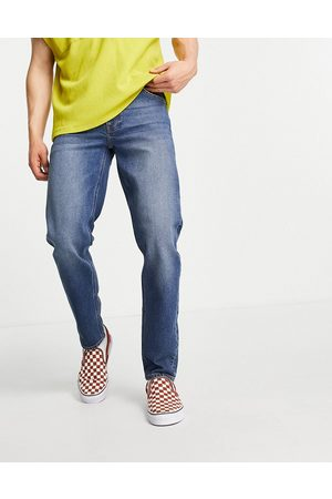 ASOS Stretch tapered jeans in dark wash-Blue