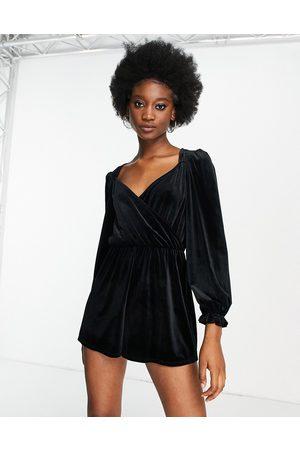 Miss Selfridge Velvet wrap front playsuit in black