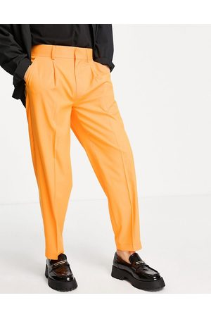 ASOS Oversized tapered smart trousers in orange