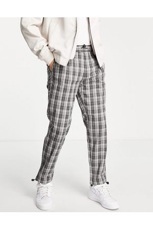 Topman Relaxed check trousers in navy with bungee cord