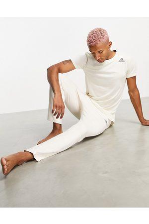 adidas Adidas Yoga joggers with tonal logo in beige-White