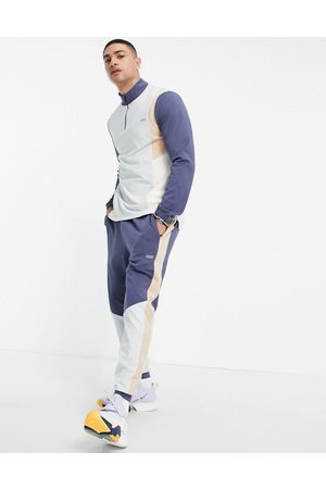 ASOS Skinny training joggers with contrast panels-Blue