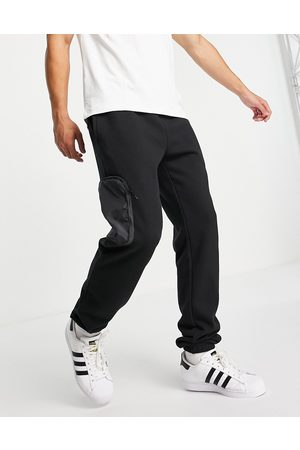 adidas RYV joggers in black with leg pockets