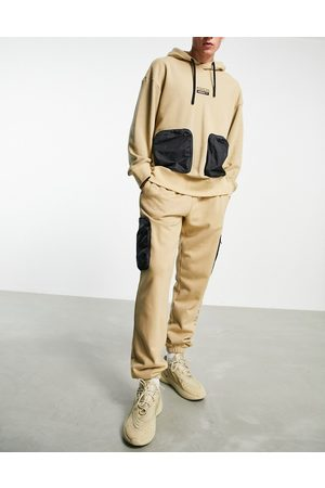 adidas RYV joggers in tone with leg pockets-Neutral