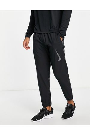 Nike Run Division Challenger Flash woven jogger in black