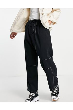 ASOS Loose fit trousers with contrast stitch in black - BLACK