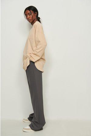 NA-KD Dame Langermede - Økologisk oversized t-skjorte med sidesplitt