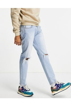 ASOS Stretch tapered jeans in vintage light wash blue with knee rips