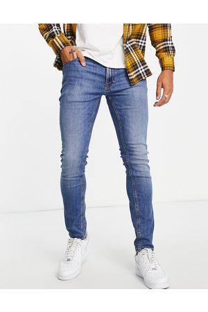 JACK & JONES Intelligence Pete carrot fit jeans in light wash blue