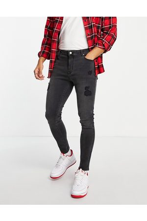 ASOS Spray on jeans with power stretch in washed black with abrasions