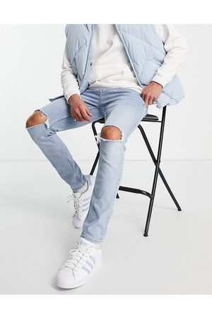ASOS Skinny jeans in light wash with knee rips-Blue