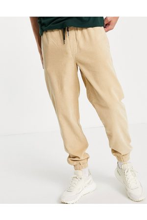 Topman Relaxed cord jogger trousers in stone-Neutral