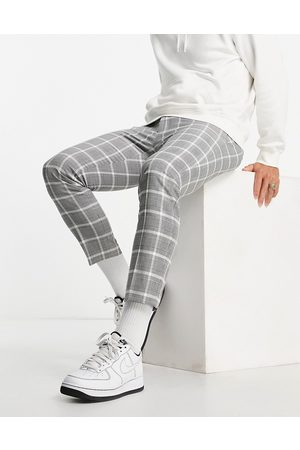 Topman Skinny pow checked jogger trousers in black and white